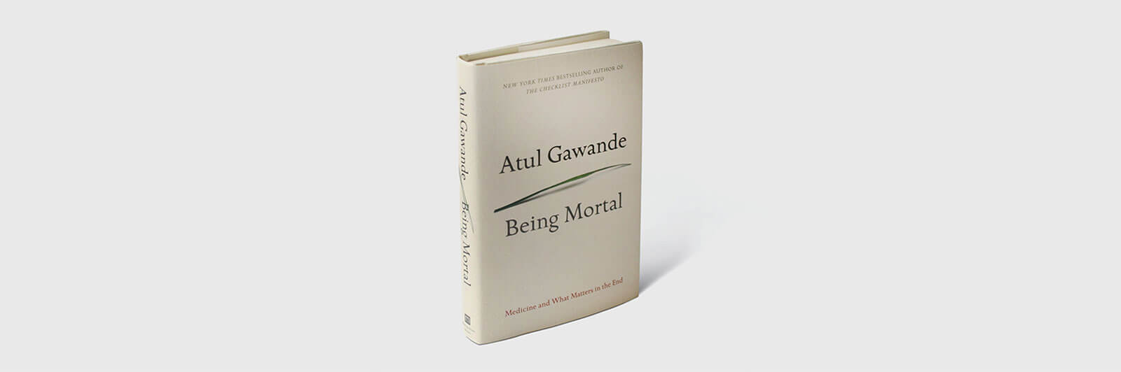 Being Mortal book cover with grass blade
