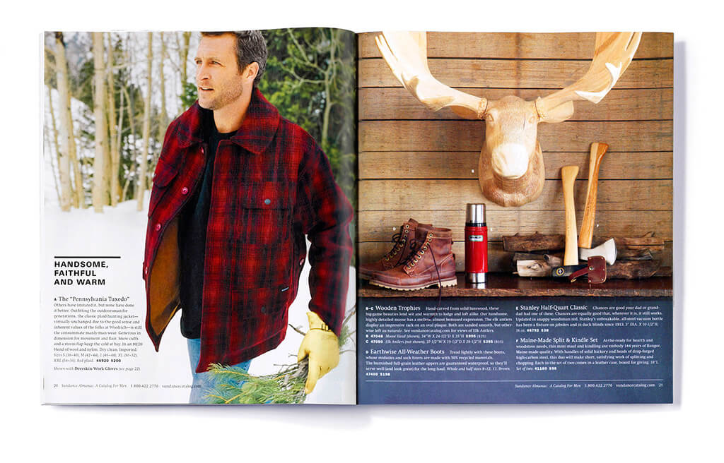 Open catalog spread showing a wooden animal head and a man in a red plaid coat