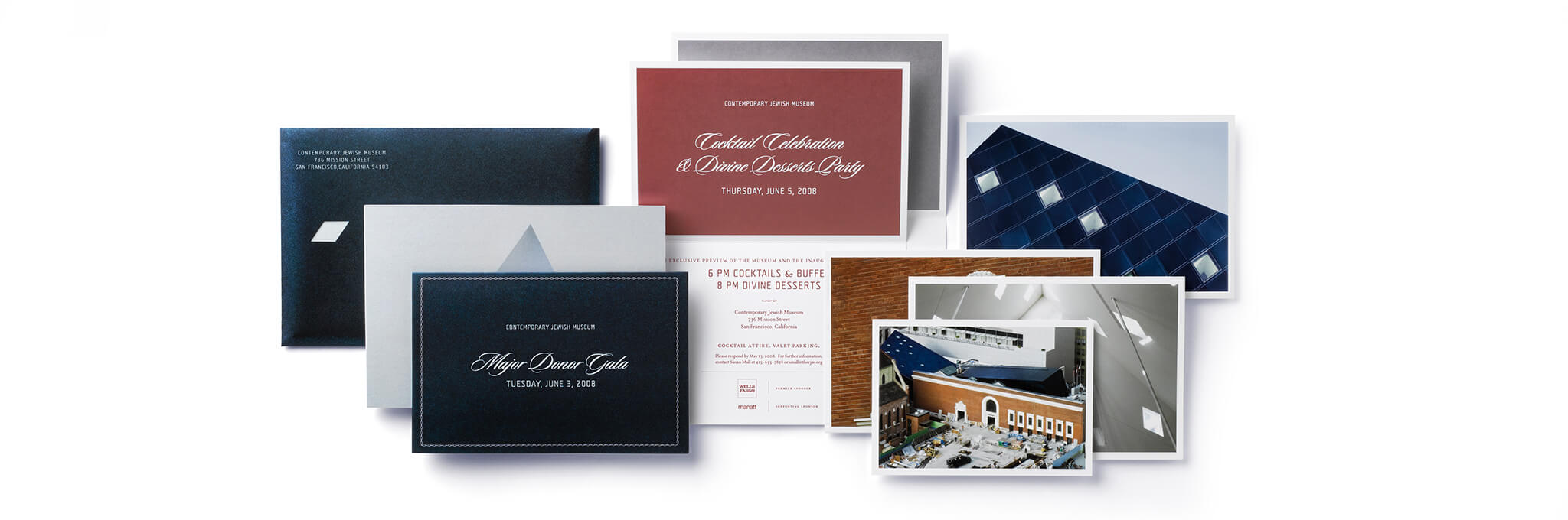 Invitation suite with cards, photos, and navy envelope