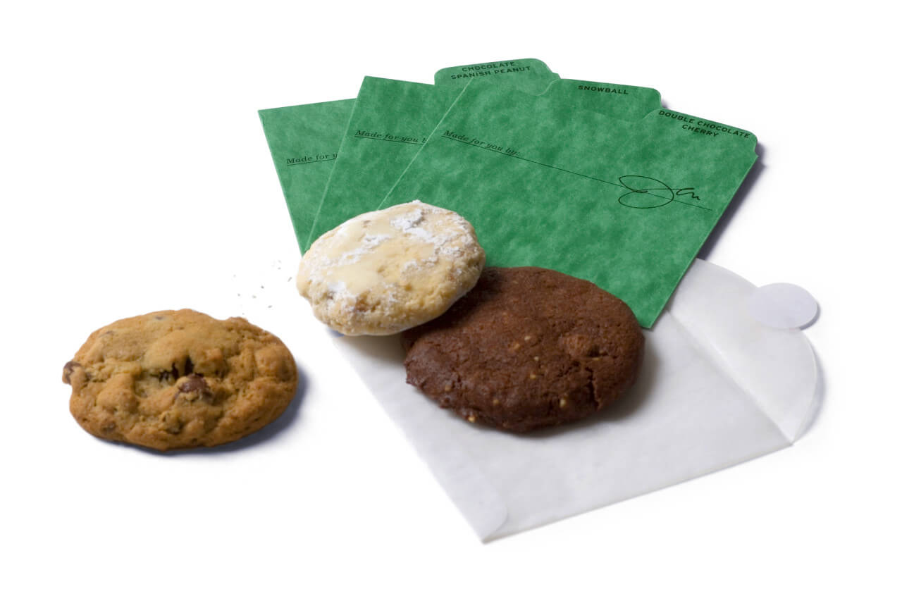3 cookies with green separators and 1 glassine cookie envelope