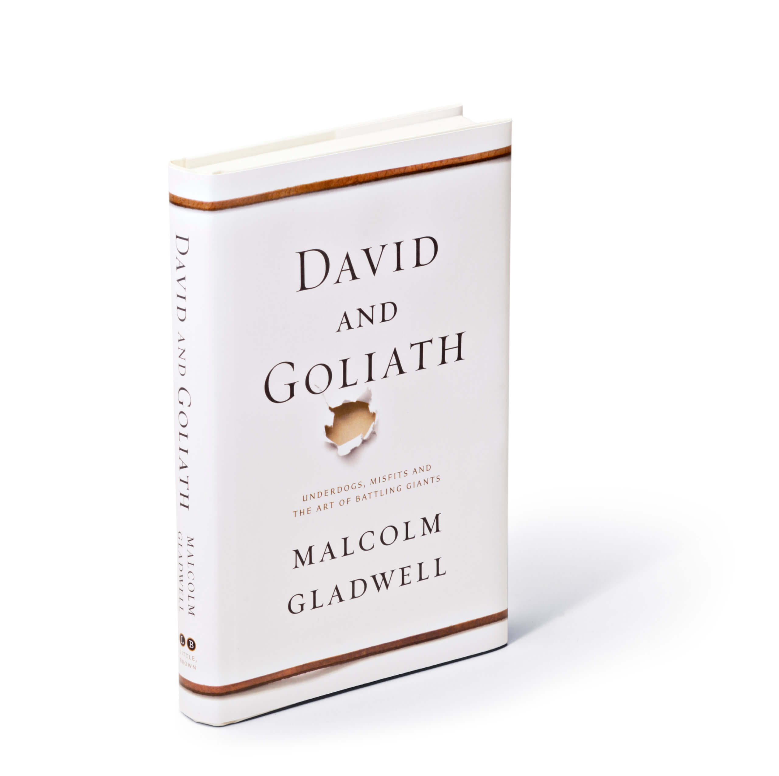 Hole punched through white paper below David and Goliath title on book cover