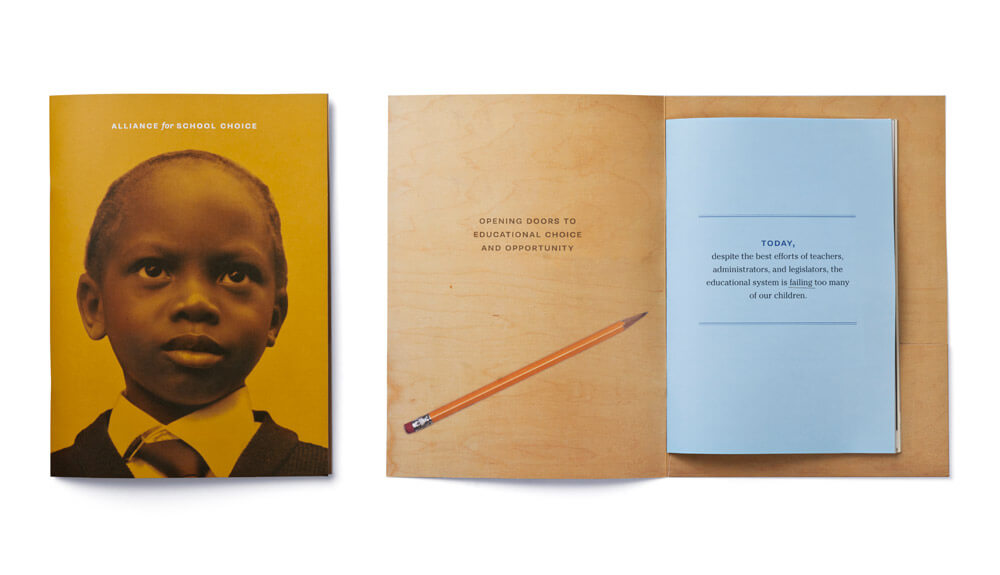 Deep yellow booklet cover with face of child and open interior spread showing blue sheet