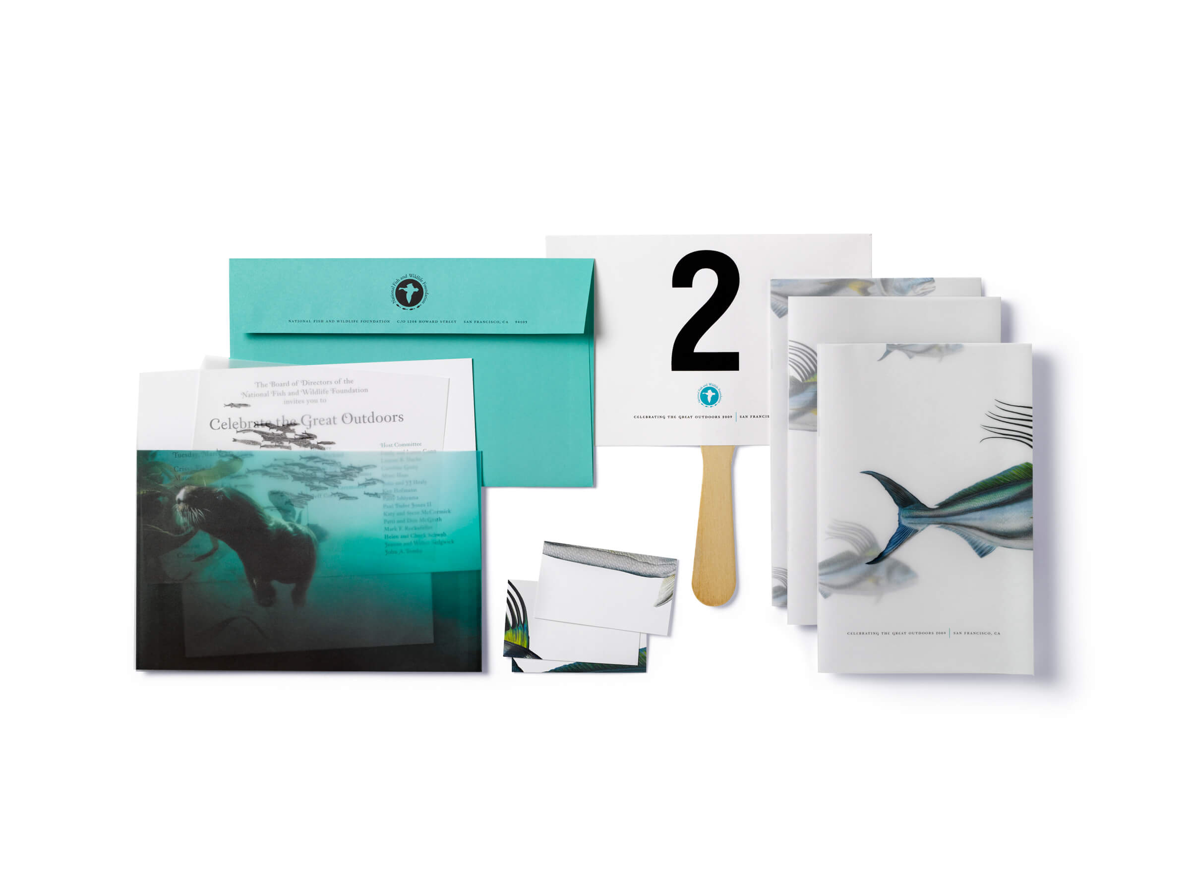 Sea creature themed program books, cards, invitation with teal envelope, and #2 paddle
