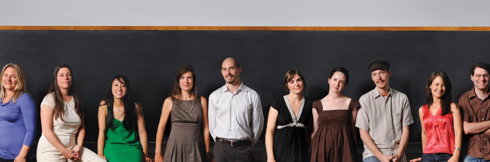 10 Elixir members in front of black chalk board