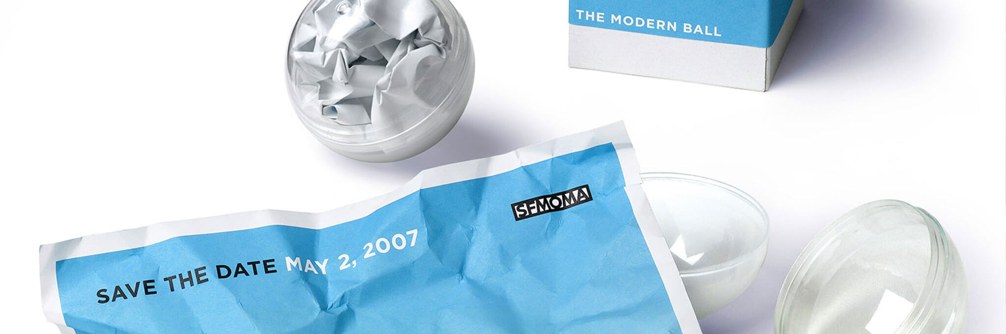 Crumpled paper ball with cropped blue May 2, 2007 Save the Date letterhead