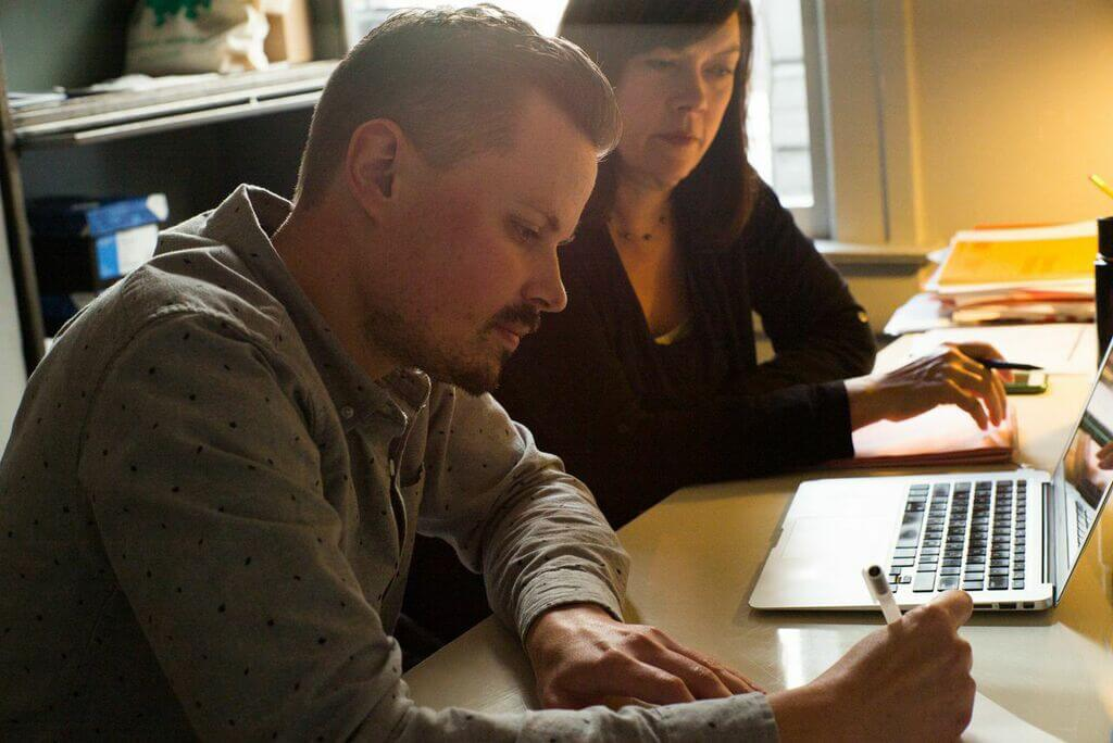 Scott and Maria working together at desk