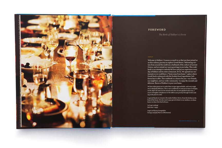 Open book showing dinner table of glasses and plates adjacent to page of text