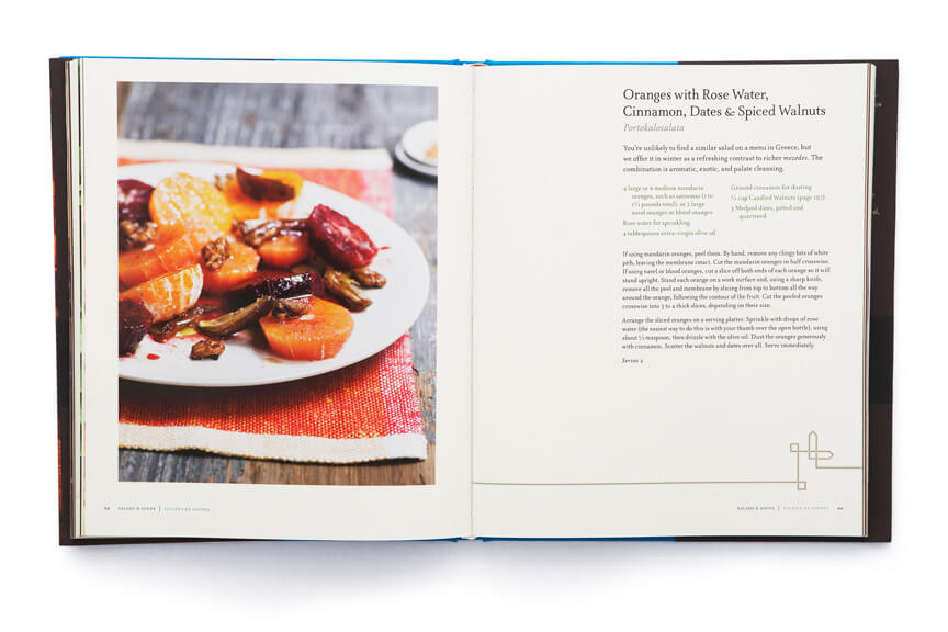 Open cookbook showing plated citrus slices adjacent to page of text