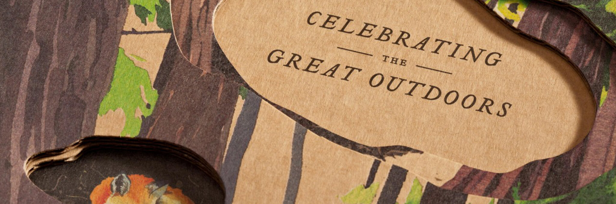 "Close-up detail of ""Celebrating the Great Outdoors"" painted cardboard invitation"