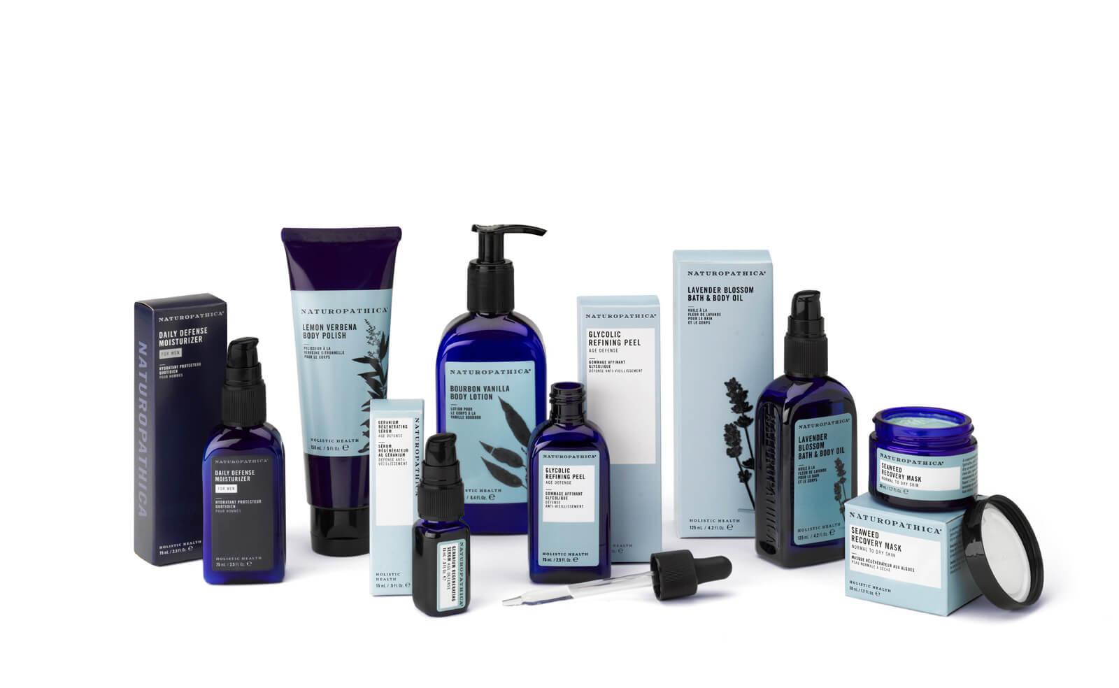Light/dark blue Naturopathica bottles, tubes, and box packaging