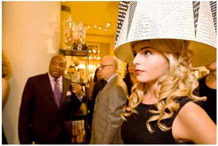 Woman wearing typographic lampshade headdress
