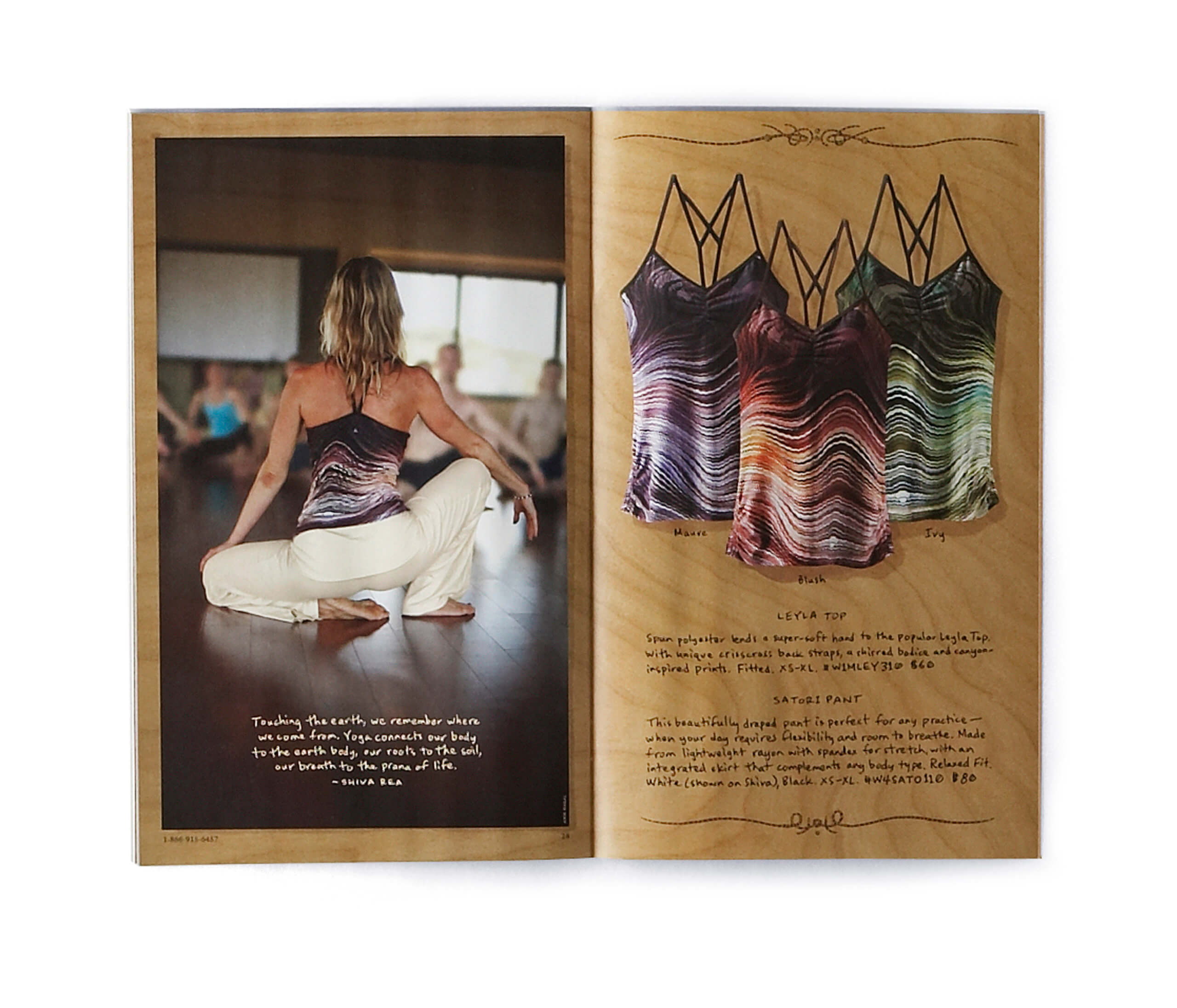 Open catalog showing yogi and 3 yoga tops on wooden background