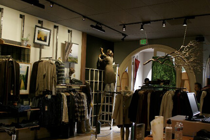 Clothing store interior with arched doorway