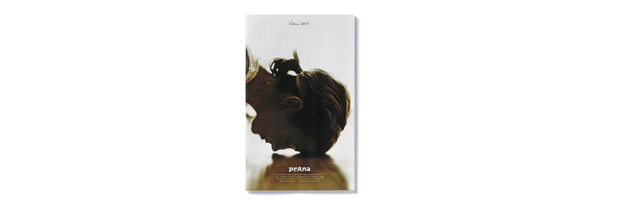 Prana catalog cover with yogi's forehead resting on floor