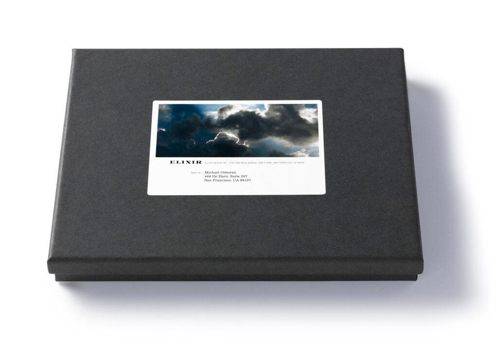 Dark gray box with stormy sky shipping label