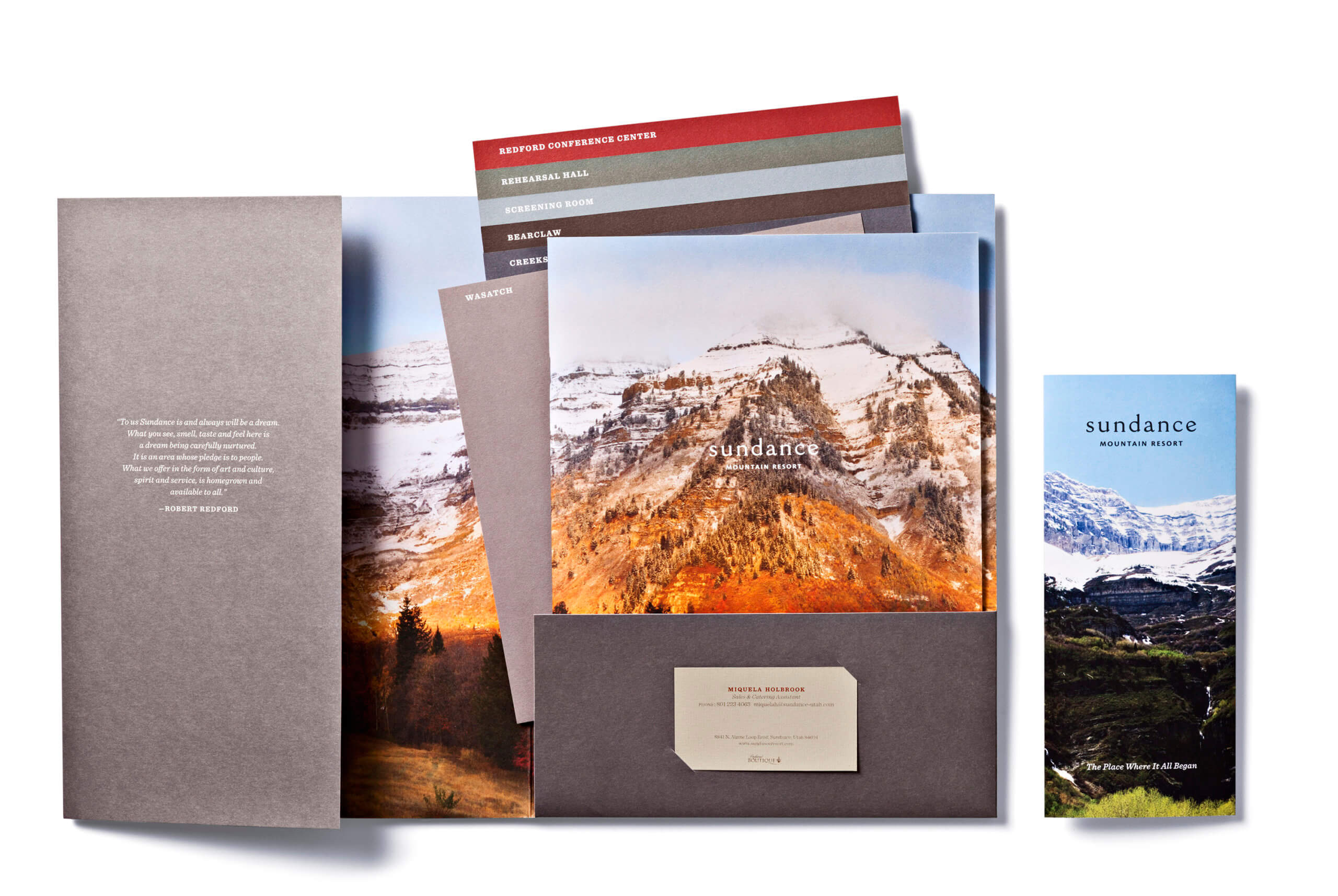 Open folder with Sundance brochures and colorful, stepped pages